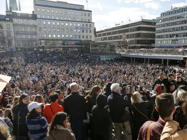 Fans of DJ Avicii gather for a minute's silence in his honour at Sergels Torg, Sweden. Picture: AP