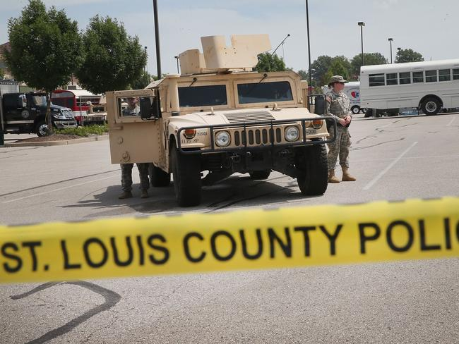 Military police stand guard in Ferguson. Pic: AFP