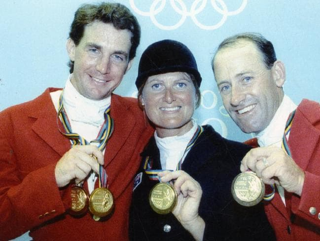 Australian Olympic gold medal-winning equestrians Matthew Ryan, Gillian Rolton and Andrew Hoy with their gold medals won at the 1992 Barcelona Olympic Games.