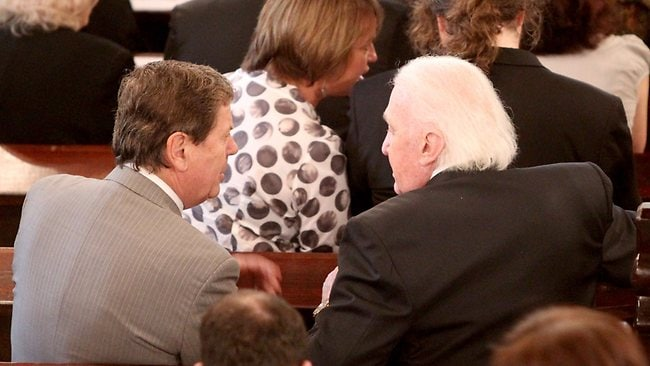 Ray Martin and John Laws catch up during the service. Picture: John Grainger