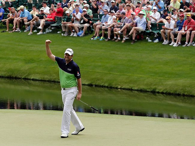 Leishman reacts after sinking a birdie on the 16th green at Augusta.