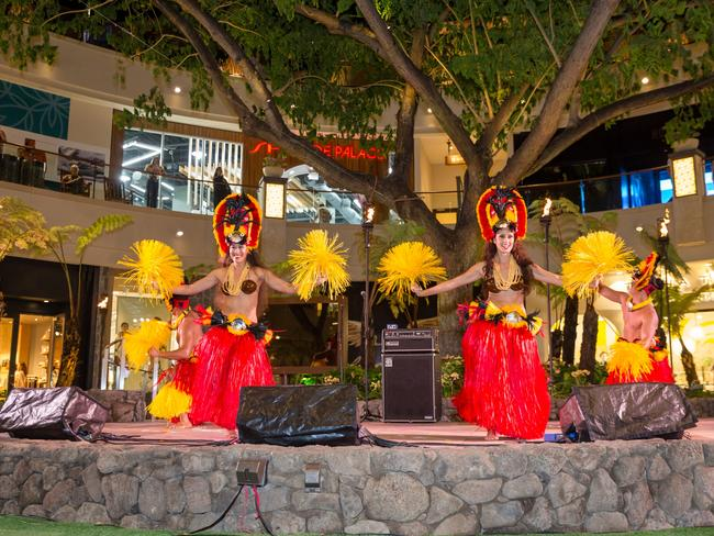 Soak up the atmosphere at the International Market Place in Waikiki.