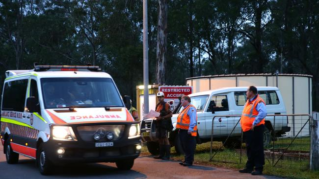One the scene ... an ambulance leaves the Austar mine west of Newcastle on April 15 following an horrific underground collapse that claimed the lives of two workers. Picture: Bill Hearne