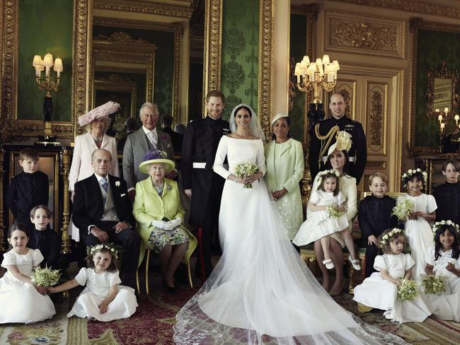 Wedding portrait. Pictured with Prince Harry and Meghan from left, back row, Jasper Dyer, Camilla, Duchess of Cornwall, Prince Charles, Doria Ragland, Prince William; centre row, Brian Mulroney, Prince Philip, Queen Elizabeth II, Kate, Duchess of Cambridge, Princess Charlotte, Prince George, Rylan Litt, John Mulroney; front row, Ivy Mulroney, Florence van Cutsem, Zalie Warren, Remi Litt. (Alexi Lubomirski/Kensington Palace via AP)