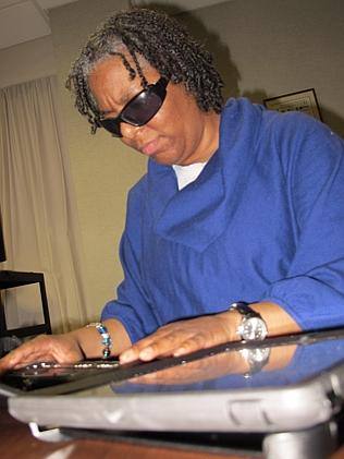 Free service... Tanisha Verdejo using a specially designed keyboard that helps blind clie