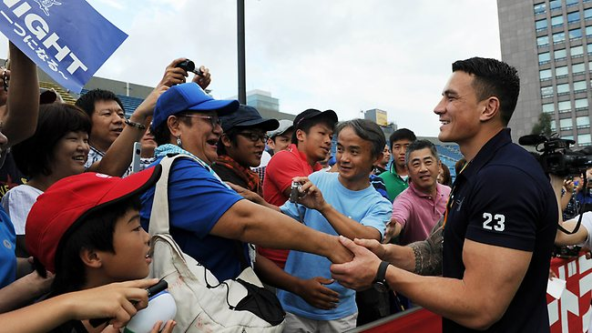 Sonny Bill Williams greets supporters of his new team, Japanese rugby union outfit Panasonic Wild Knights, in Tokyo.