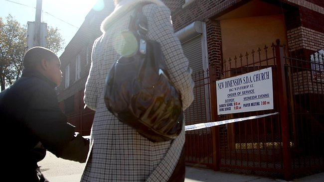 Pedestrians walk past New Dimension Church where Vindalee Smith was to supposed to be married. Her landlord found her dead the day before the service. Picture: AP /Seth Wenig