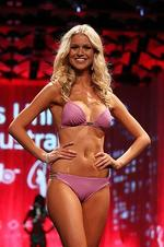 <p>Eventual winner Renae Ayris of Western Australia models swimwear by Kooey during the crowning ceremony to announce the 2012 Miss Universe Australia at the Sofitel Melbourne on Collins on June 8, 2012 in Melbourne, Australia. (Photo by Scott Barbour/Getty Images)</p>