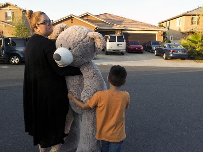 "Neighbours Liza Tozier and her son Avery Sanchez, 6, drop off his large ""Teddy"" as a gift for the children. Picture: AP"
