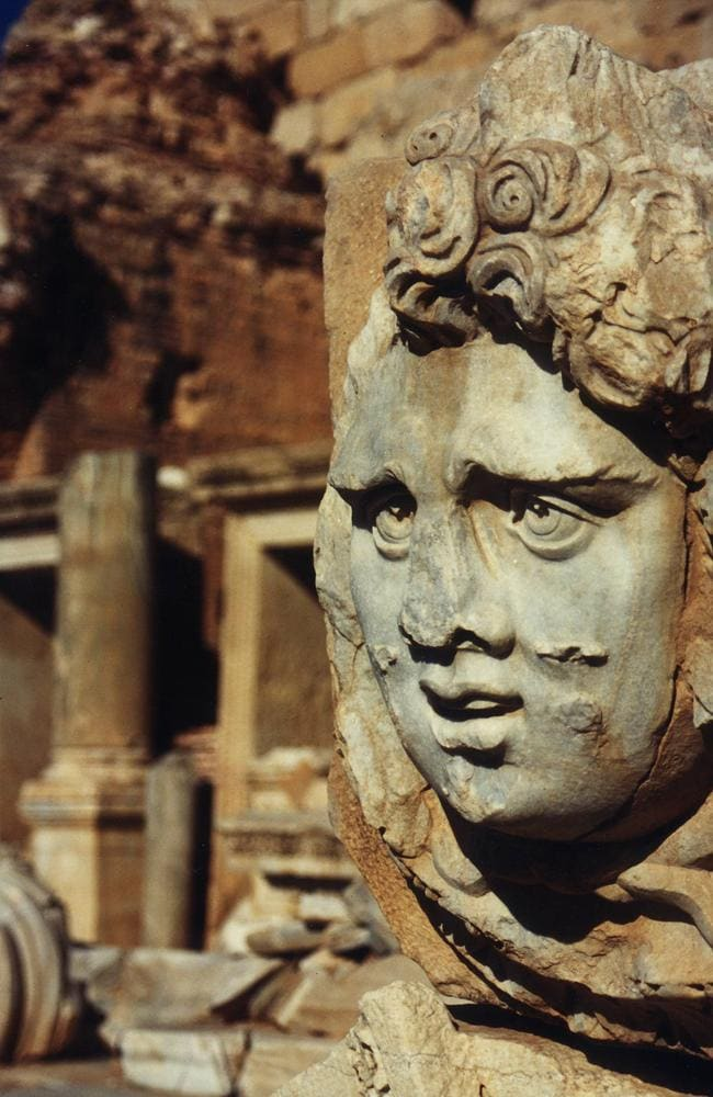 Medusa's Head statue sculpture in ruins of ancient city.