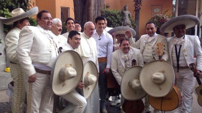 The pope celebrates with the band at his Mexican farewell party catered by Joe Ibarra. Picture: Joe Ibarra / Newsmodo
