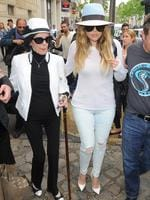 Proud (and stylish) grandmother Mary Jo Shannon is helped by Khloe Kardashian as they leave Kim's apartment in Paris. Picture: Splash