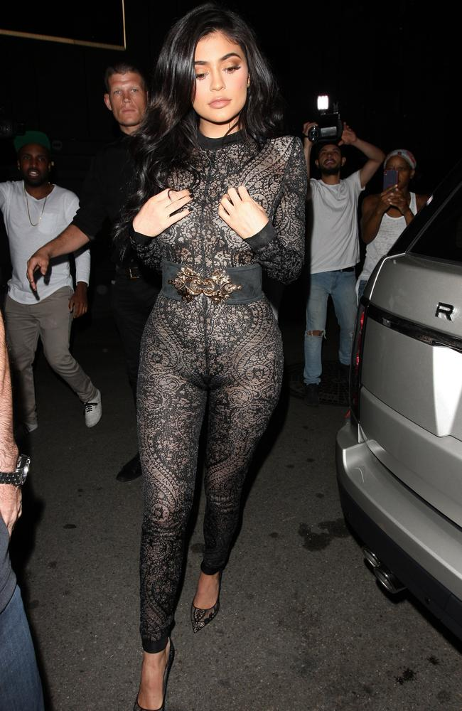Kylie jenner stuns in see through lace jumpsuit as she kicks off early