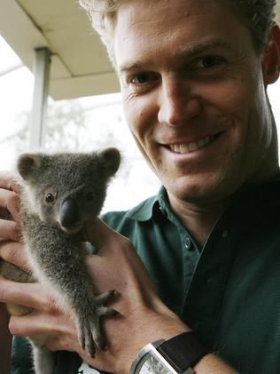 Too cute ... Chris checks over a newborn koala at a Sydney sanctuary. Picture: Supplied