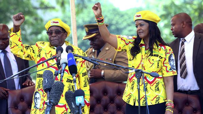 Zimbabwe's president Robert Mugabe said on Wednesday he fired his deputy and longtime ally for scheming to take power, including by consulting witch doctors. Now Mugabe's wife Grace appears poised for the role. Picture: AP.