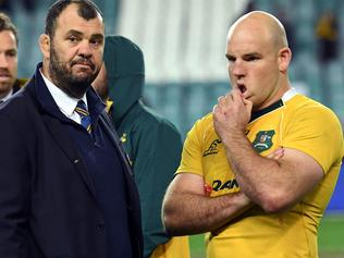 Australian rugby coach Michael Cheika (L) and captain Stephen Moore (R) talk after their loss to England in the third and final rugby union Test match in Sydney on June 25, 2016. / AFP PHOTO / WILLIAM WEST