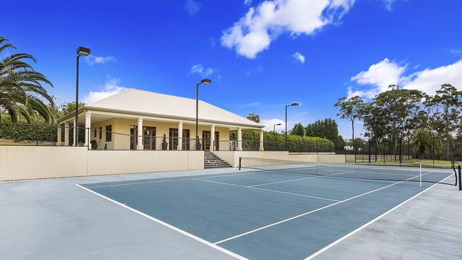 Naturally, the property includes two tennis courts.