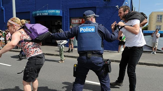 Police remove East West Link protesters trying to stop a construction truck from leaving on the corner of Alexandra Pde and Charlotte St, Collingwood.