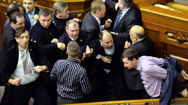 Ukrainian deputies of the pro-Russian majority argue with pro-EU opposition MPs during a parliament session to debate the 2014 state budget in Kiev. Picture: Sergei Supinsky