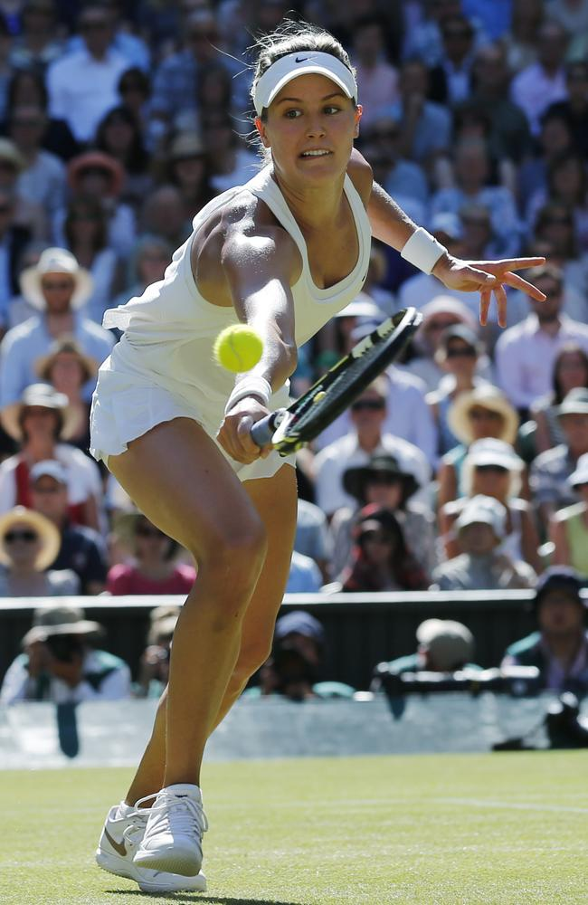 Bouchard stretches to reach the ball in her Wimbledon semi-final.