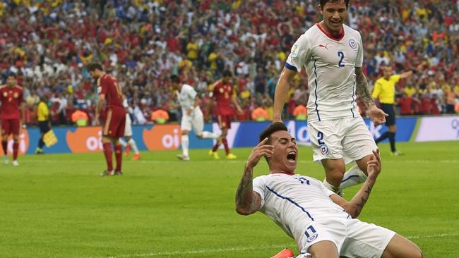 Chile's Eduardo Vargas celebrates after scoring the opening goal.