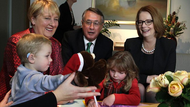 Prime Minister Julia Gillard, Treasurer Wayne Swan and Minister for Disability Reform Jenny Macklin with children with disabilities and their parents at Parliament House today after the Prime Minister introduced the Government's NDIS bill. Picture: Ray Strange