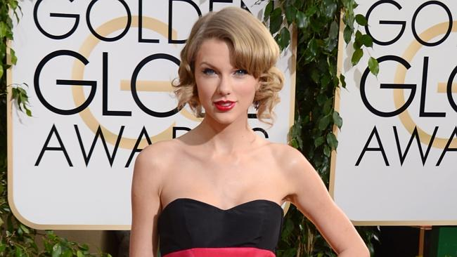Taylor Swift arrives at the Golden Globes.