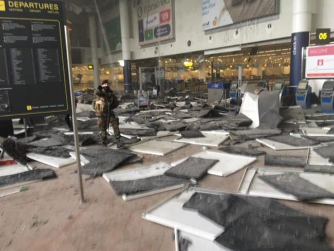 Brussels Airport transit hall after bomb explosions reported.