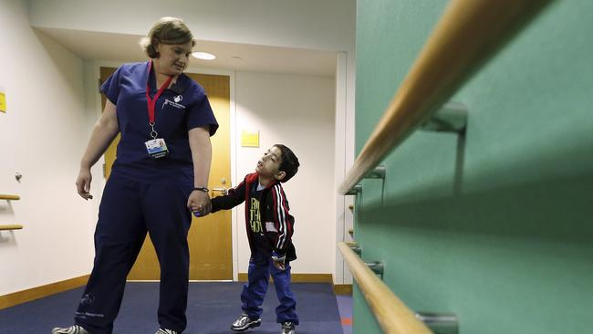 Taking his first steps again ... Ihor Lakatosh at Shriners Hospital for Children in Boston. Picture: Michael Dwyer