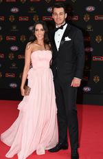 Robbie Tarrant and partner Jess Jafer poses for photos on arrival at the Brownlow medal ceremony at Crown in Melbourne, Monday, September 25, 2017. Picture: AAP Image/James Ross