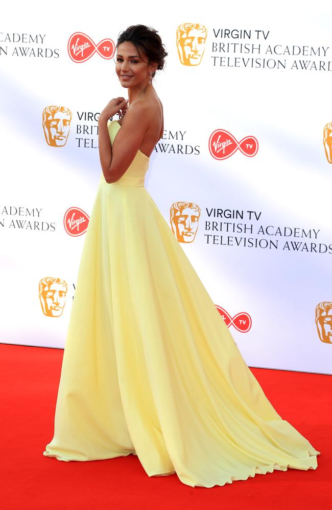 Our Girl leading actress Michelle Keegan looked gorgeous in a lemon coloured strapless princess gown. Picture: Fred Duval/MEGA