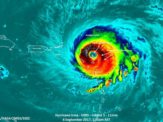 At least eight are dead as historic Category 5 Hurricane Irma charts its path towards Florida. Pictured, Irma passing over the island of Barbuda. Picture: NASA/NOAA/UWM-CIMSS, William Straka III