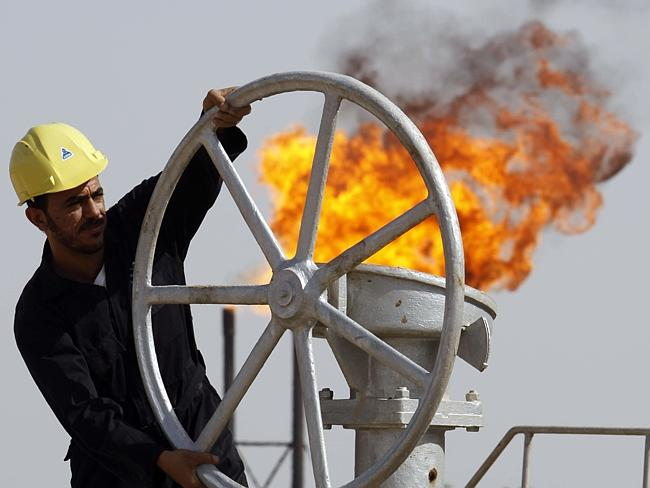 Attacking supply ... an Iraqi oil worker at the Nahran Omar oil refinery near the city of