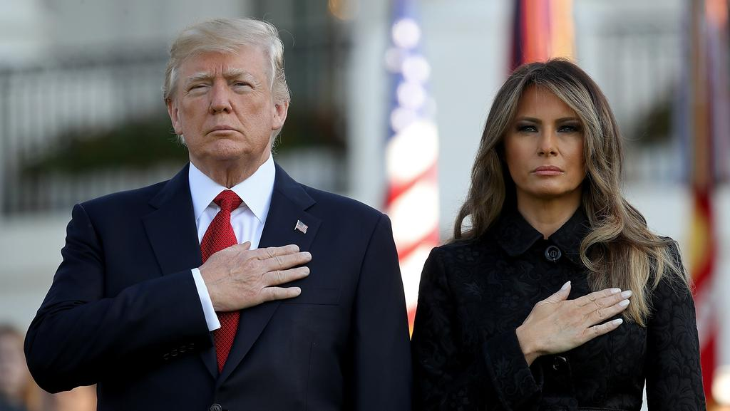 President Donald Trump and first lady Melania Trump, observe a moment of silence on the South Lawn for the September 11 terrorist attacks. Picture: Getty