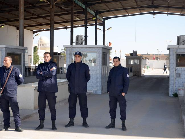 Tunisia police stand guard in front of the closed border between Tunisia and Libya after the Tunisian government closed the border between the two countries following a deadly suicide bombing claimed by Islamic State. TITLE: ISIS Affiliates in Libya Present Growing Threat