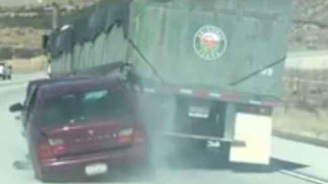 Video shows the Nissan being dragged along California's Interstate 15. Picture: Facebook