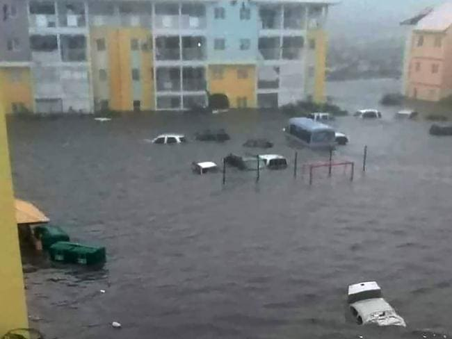A flooded street with cars underwater in the French island of Saint Martin. Picture: AFP/Twitter Rinsy Xieng