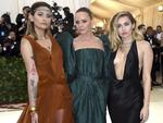 Paris Jackson,from left, Stella McCartney and Miley Cyrus attend the Heavenly Bodies: Fashion and The Catholic Imagination Costume Institute Gala at The Metropolitan Museum of Art on May 7, 2018 in New York City. Picture: AP
