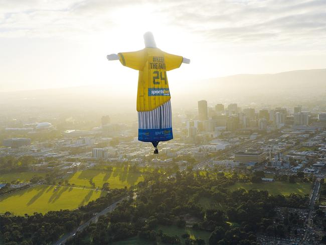 The Christ the Redeemer hot-air balloon, promoting Sportsbet, floats over Adelaide. Picture: John Gollings