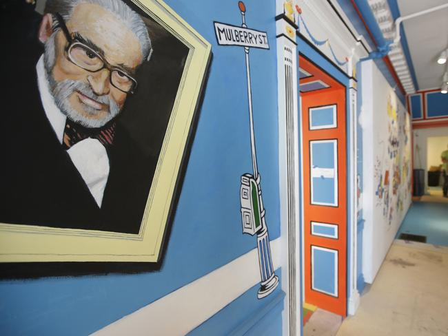 A mural that features Theodor Seuss Geisel, left, also know by his pen name Dr. Seuss, rests on a wall near an entrance at The Amazing World of Dr. Seuss Museum. Picture: AP/Steven Senne