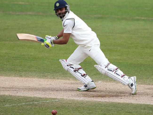 Ravindra Jadeja opens the face of his bat and cuts the ball away for a couple of runs.