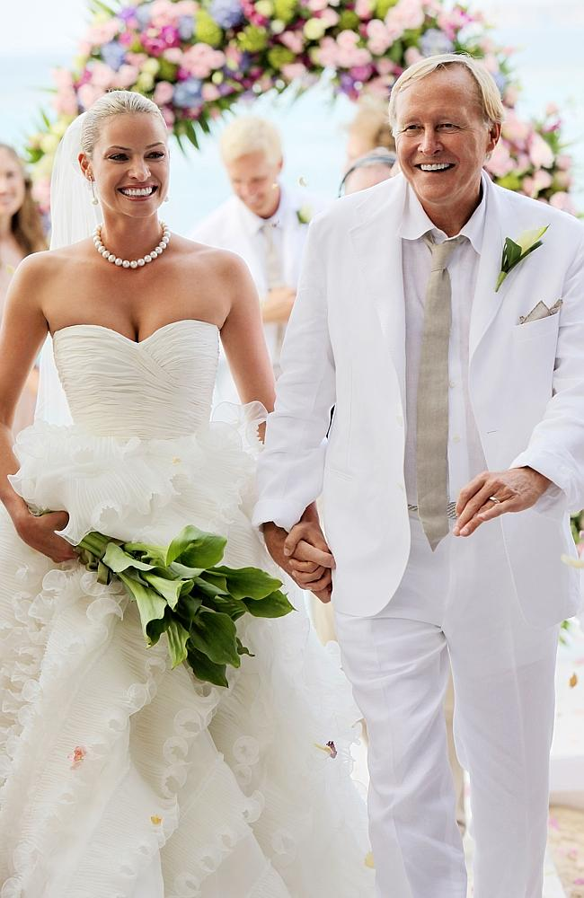 Kristy Hinze with billionaire husband Jim Clark during their wedding ceremony on the beach at the Little Dix Day Resort.