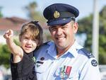 Australian Air Force LAC Christopher Sarquis with his 3 year old daughter Ally at the Caloundra Anzac Day Parade. Picture: Lachie Millard