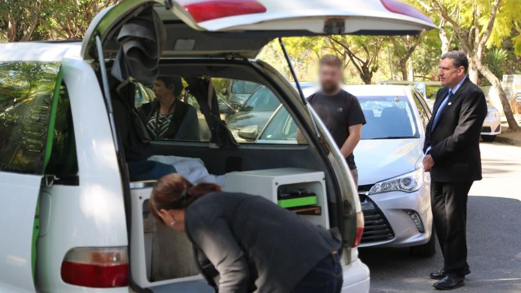 The British tourist looks on as his vehicle is searched. Picture: Supplied