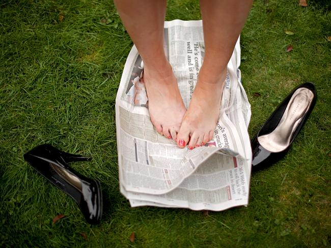 The paper comes in handy to rest weary feet.