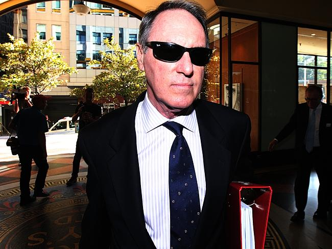 Child sexual assault ... Former Hey Dad! star Robert Hughes entering Downing Centre Courts.