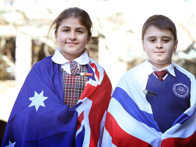 Chloe Younan and Nineal Hawei, 11, are the school captains of St Hurmzd Assyrian Primary School who spoke to the crowd gathered at Belmore Park. Picture: Craig Greenhill