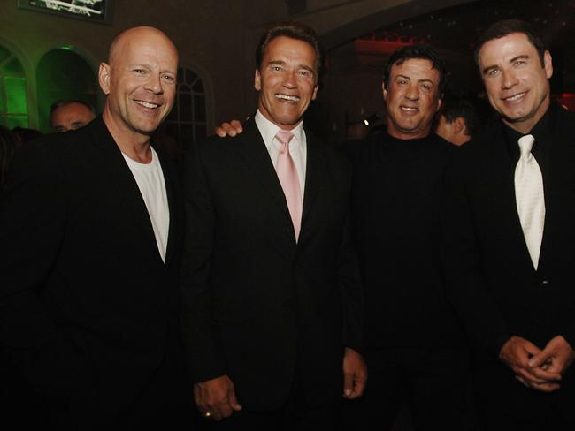 Back then ... Planet Hollywood founders Bruce Willis, left, California Gov. Arnold Schwarzenegger, second left, and Sylvester Stallone, posing with John Travolta to celebrate Slys 60th birthday.
