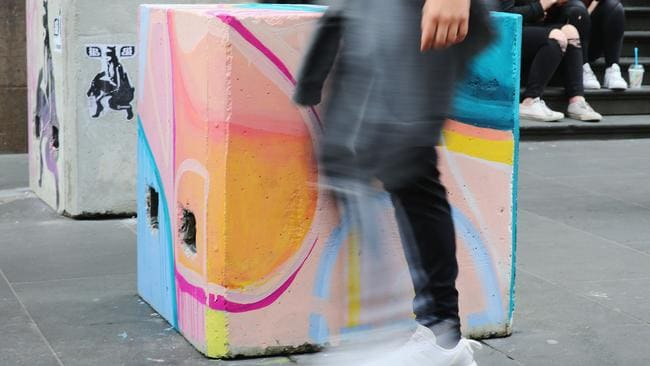 Artwork is seen on many concrete blocks acting as bollards in Melbourne, Australia. Picture: Michael Dodge/Getty Images.