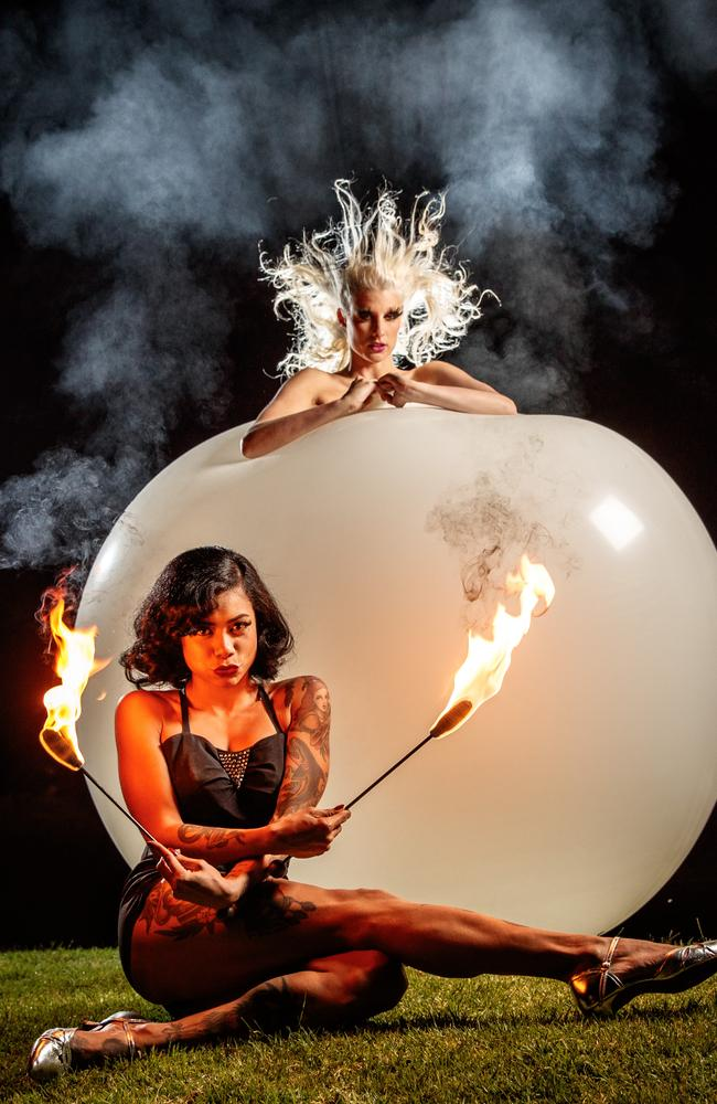 ON FIRE: Limbo Unhinged fire artist and sword swallower Heather Holiday and Blanc de Blanc burlesque performer Jaimie Luhrmann bursting out of a giant balloon. Picture: Matt Turner